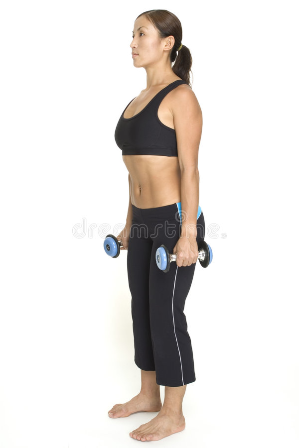 Squat 2. A female fitness instructor demonstrates the finishing position of the squat with dumbbells royalty free stock photo