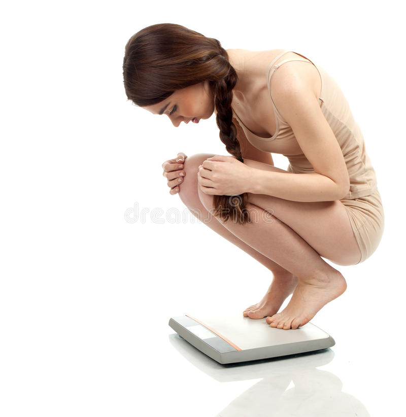 Download Squats On Scale Young Woman Stock Photo - Image: 19370518