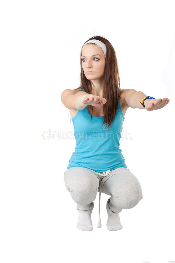 Squatting girl royalty free stock image