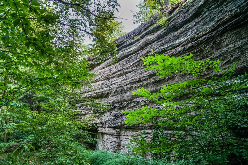 Squeeze Through the Crack in the Ground. This is Thompson Ledges in northeast Ohio you squeeze through the crack in the ground and it opens up to a beautiful royalty free stock images
