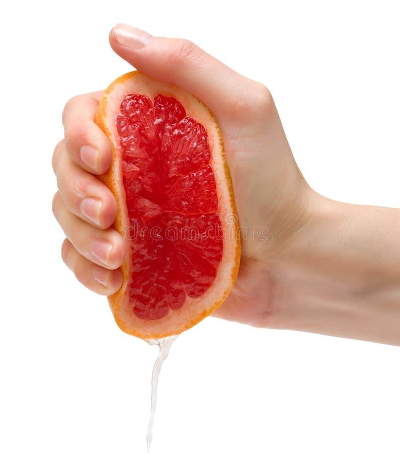 Squeeze of grapefruit royalty free stock photos