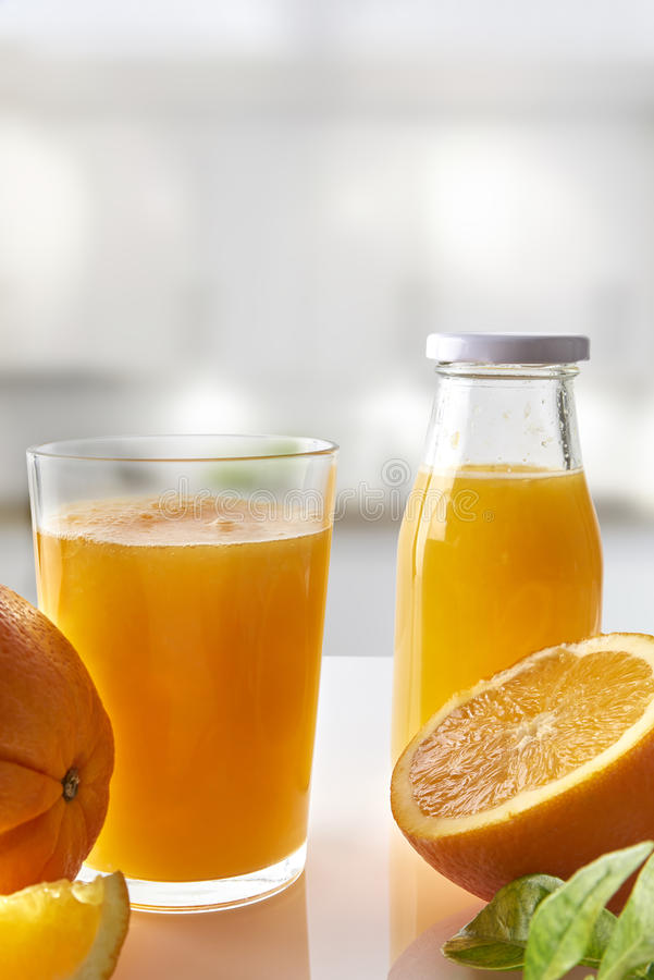 Free Squeezed Orange Juice In Glass On White Kitchen Vertical Composition Royalty Free Stock Photography - 65488877