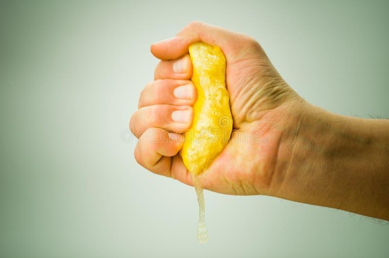 Squeezing lemon stock image