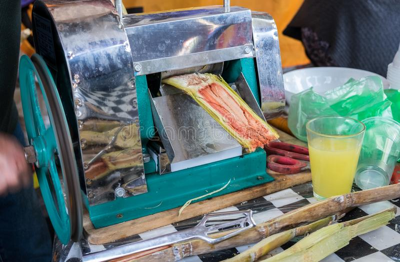 The squeezing machine for sugarcane juice royalty free stock photo
