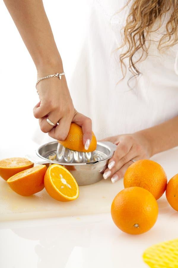 Squeezing oranges stock photography