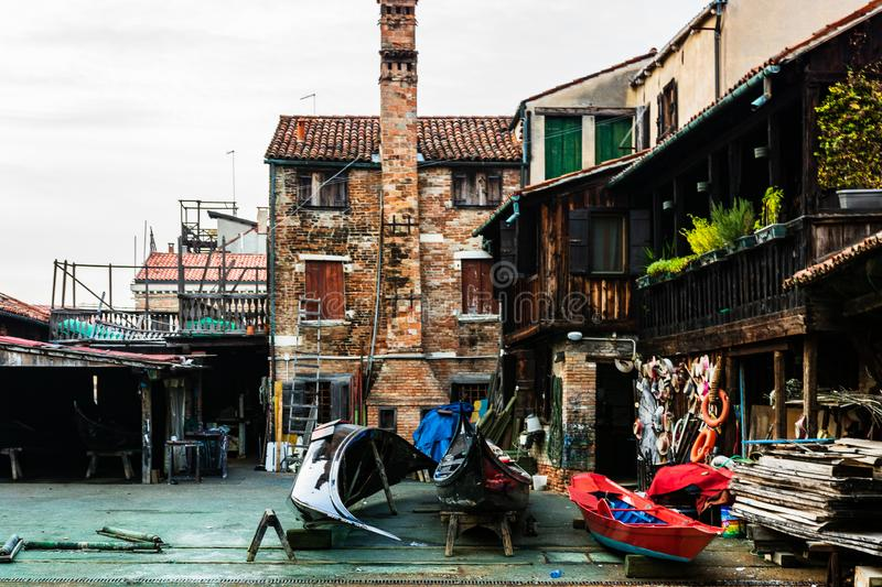 Squero di San Trovaso, old and historic boatyard for gondolas in Venice, Italy, Europe. Venice, Italy - 2019. Squero di San Trovaso, old and historic boatyard stock photos