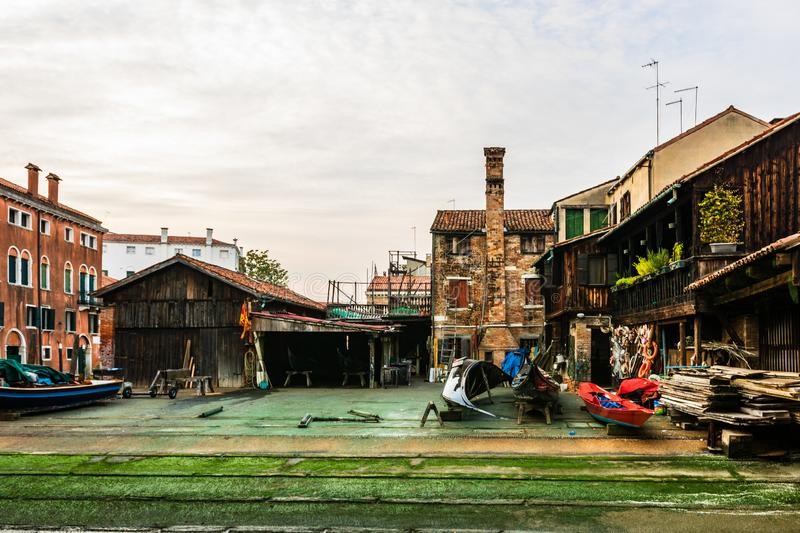 Squero di San Trovaso, old and historic boatyard for gondolas in Venice, Italy, Europe. Venice, Italy - 2019. Squero di San Trovaso, old and historic boatyard stock image