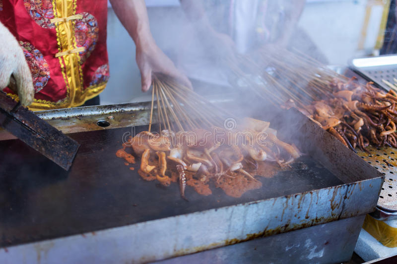 Squid barbecue. Barbecue squid with red chili and pepper, is a favorite street snacks in coastal city stock photography