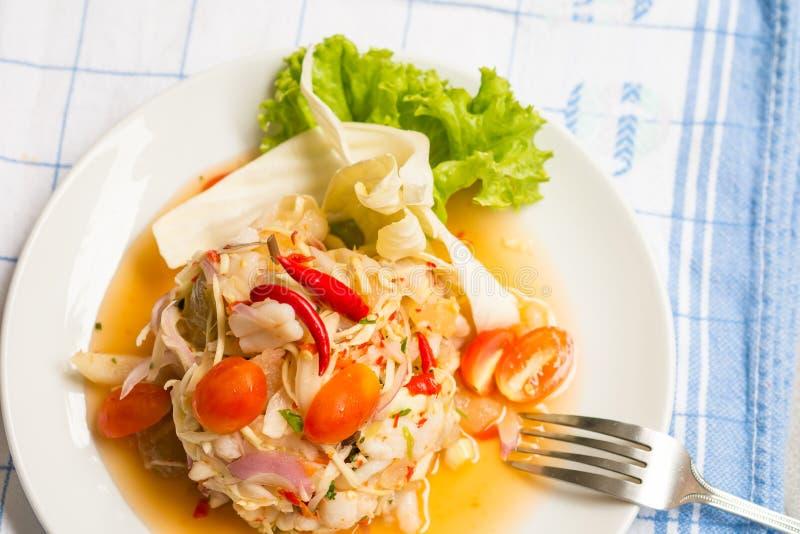 Squid eggs spicy salad stock photo