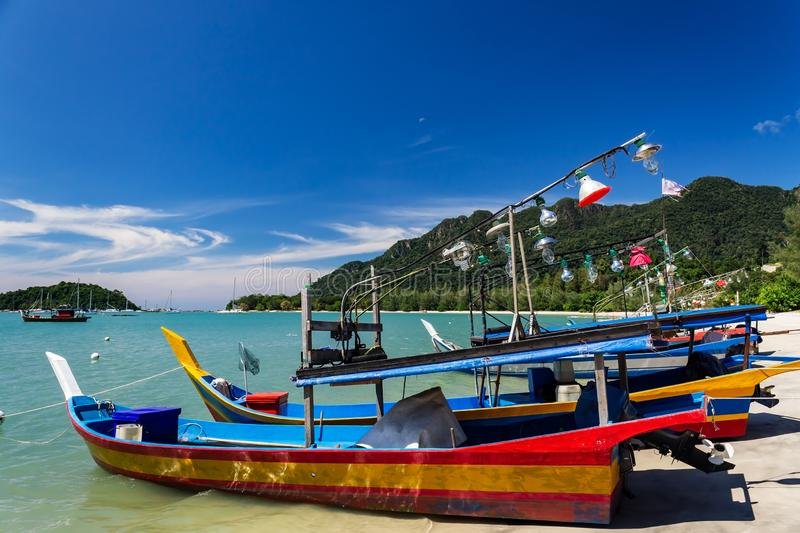 Squid fishing boats on the beach by Telaga Harbor on Langkawi island, also known as Pulau Langkawi, State of Kedah, Malaysia. Squid fishing boats on the beach by royalty free stock image