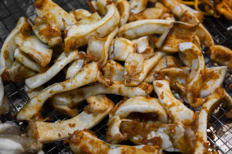 Squid grill on hot charcoal hot fire tasty delicious sea food. Grilled squid on bbq fire. Thai street food at Night stock photos