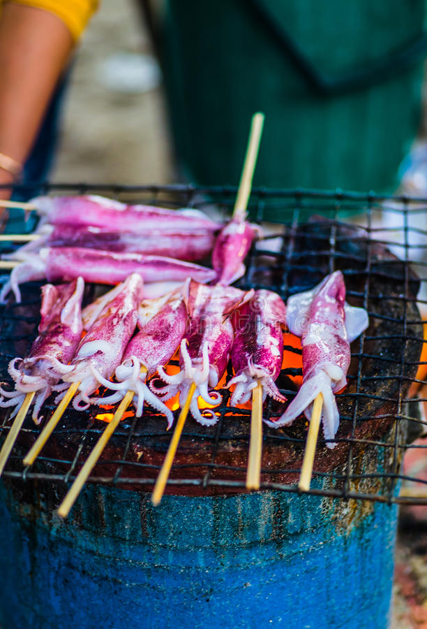 Squid on the grill stock images