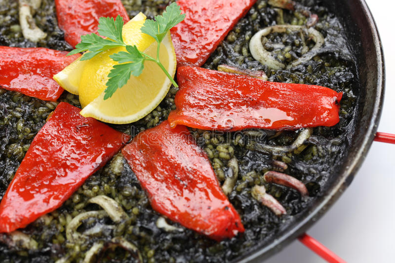 Squid ink paella. Spanish dish royalty free stock photo