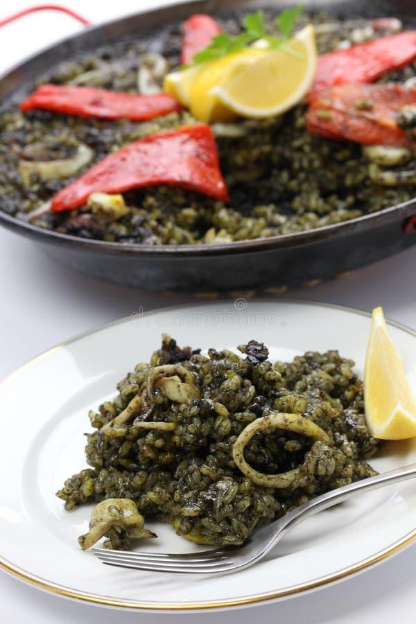 Squid ink paella. Spanish dish royalty free stock image