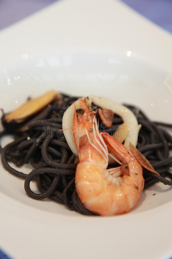 Squid ink pasta royalty free stock images