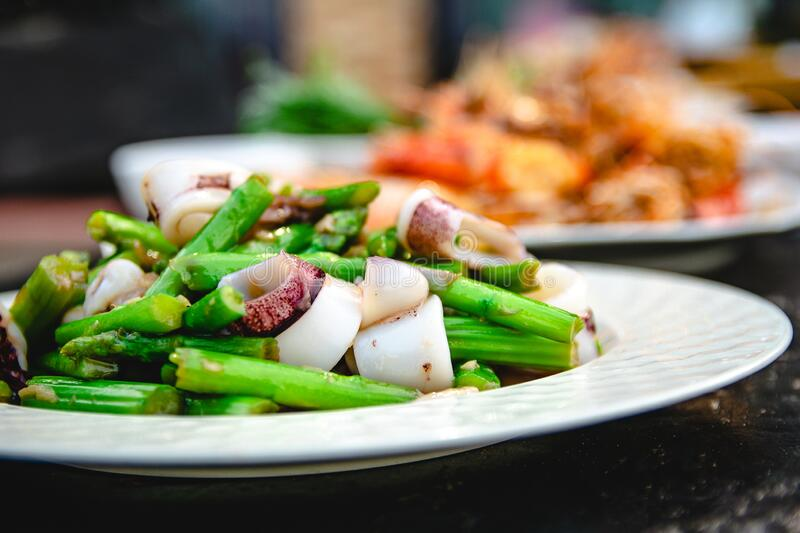 Squid puff with asparagus of restaurant with other dishes stock photos