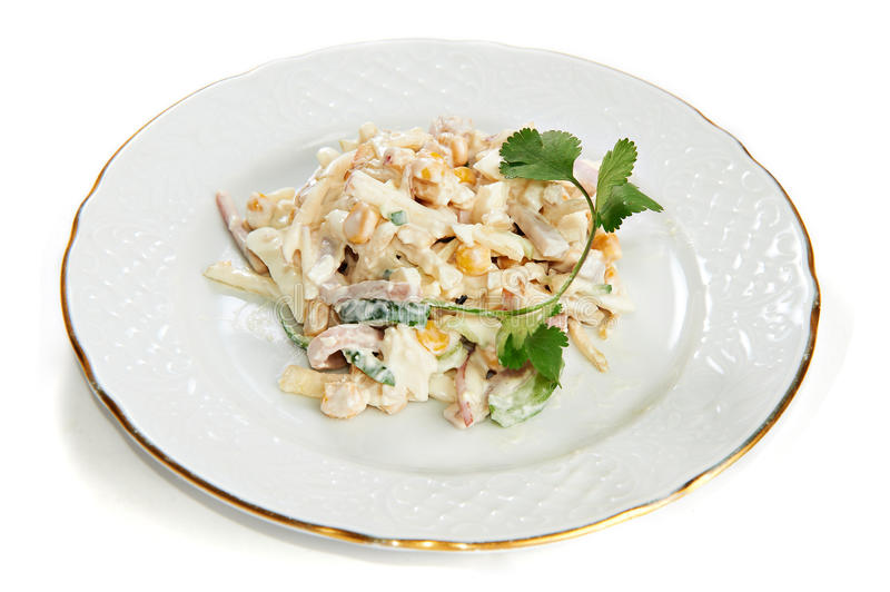 Squid salad with corn, eggs, apples isolated stock images