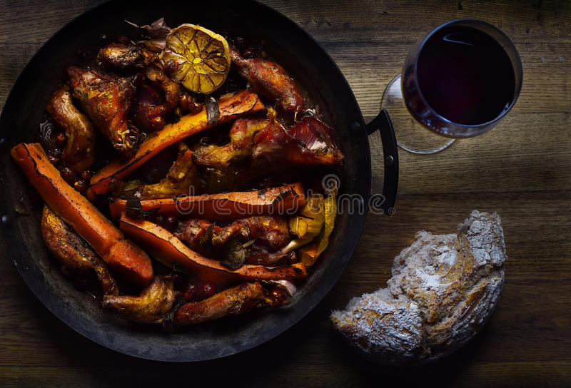 Squirrel and butternut squash. And garlic with a glass of red wine and bread stock images