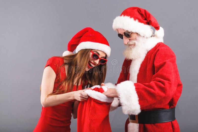sra. Claus Searching Some Presents In Santa Claus Bag foto de stock