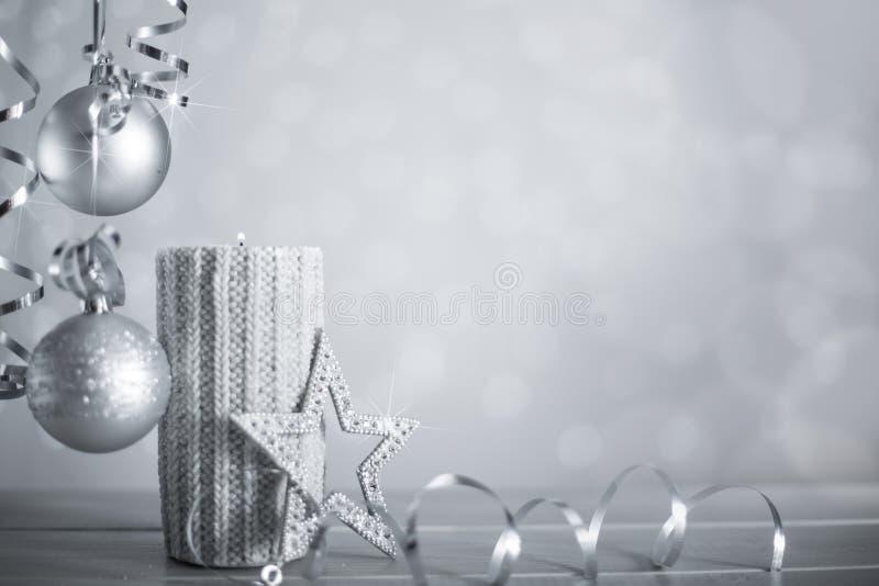Srebna Bożenarodzeniowa świeczka z faborkiem zdjęcia royalty free