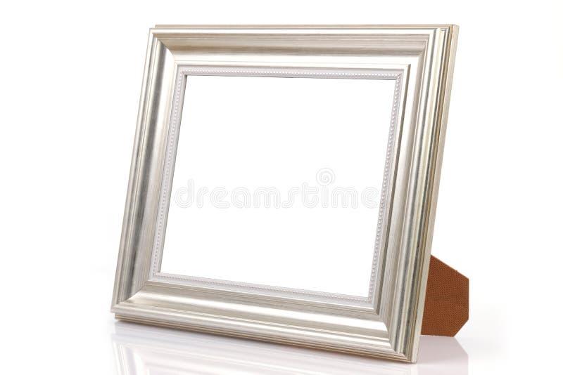 Srebna fotografii rama ODIZOLOWYWAJĄCA na Białym tle z cieniem obrazy stock