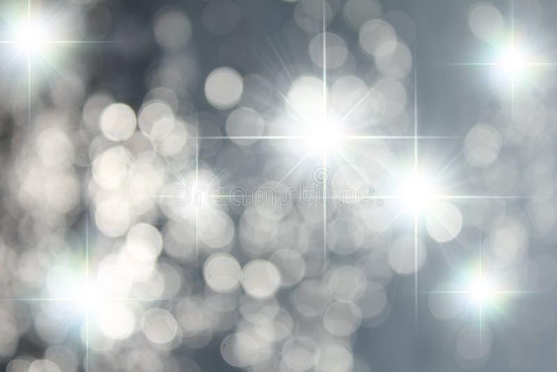 Srebro gwiazdy i Bokeh tło ilustracja wektor