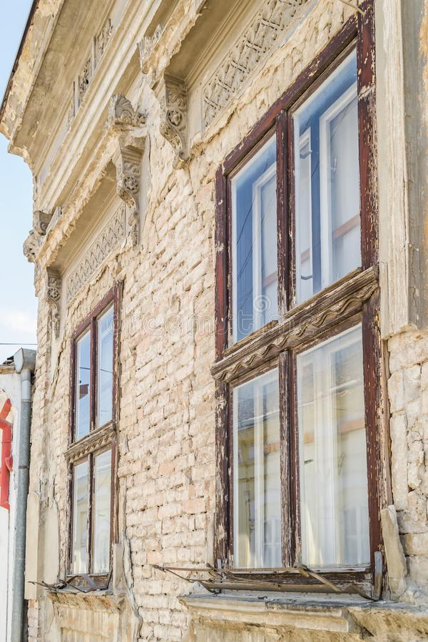The windows of the old houses in Sremski Karlovci, Serbia. Sremski Karlovci, Serbia - June 12, 2019: The windows of the old houses in Sremski Karlovci, Serbia royalty free stock image