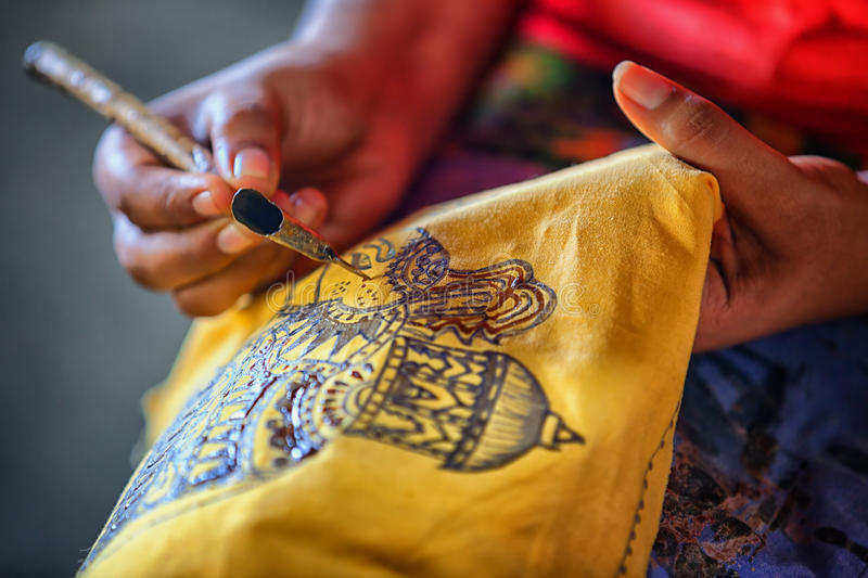 Sri Lanka. Create traditional art - batik. Spouted tool - canting. Tjanting. Sri Lanka, Anuradhapura. Artist sketching with an instrument to create a traditional stock photography
