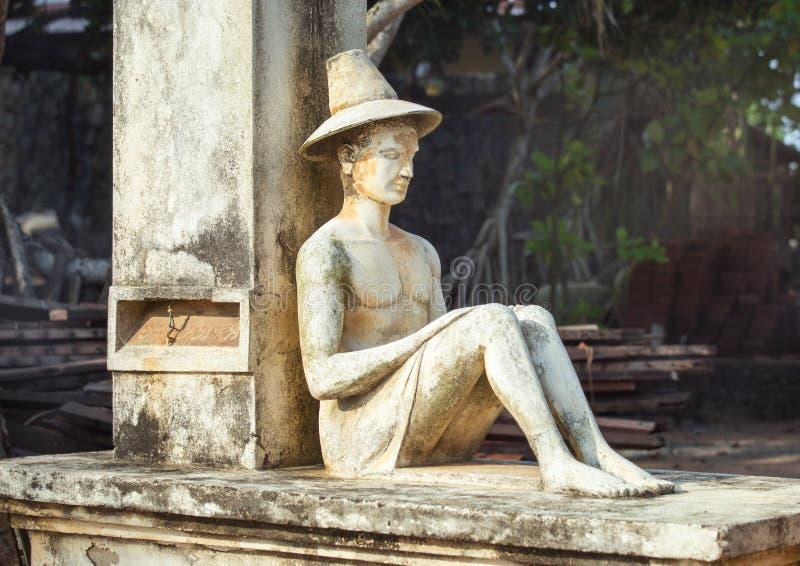 Statue of sitting man. stock photos