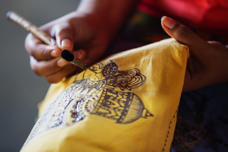 Sri Lanka. Create traditional art - batik. Spouted tool - canting. Tjanting. Sri Lanka, Anuradhapura. Artist sketching with an instrument to create a traditional stock photos