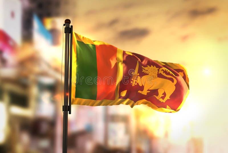 Sri Lanka Flag Against City Blurred Background At Sunrise Backlight. Sky royalty free stock image
