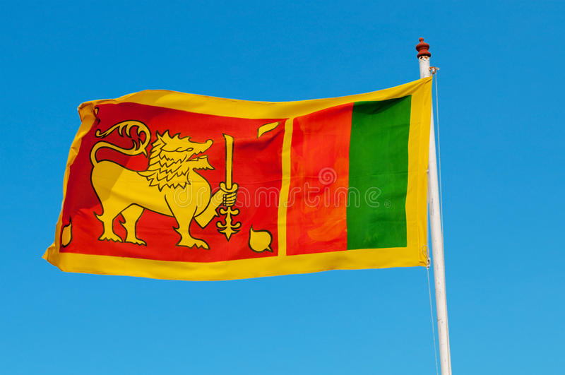 Sri Lanka flag on flagstaff. The lion represents the Sinhalese ethnicity and the bravery of the Sri Lankan nation. The orange stripe represents the Tamils, the royalty free stock photography