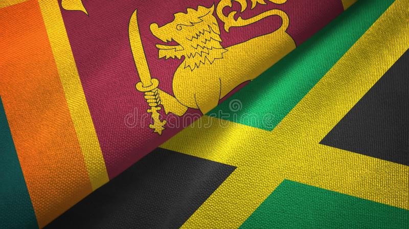 Sri Lanka and Jamaica two flags textile cloth, fabric texture royalty free illustration