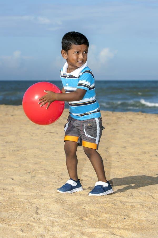 A Sri Lankan boy standing on the beach. royalty free stock photo
