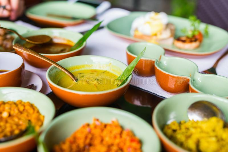 Sri Lankan food. Variety of Sri Lankan curry in bowls on table stock images