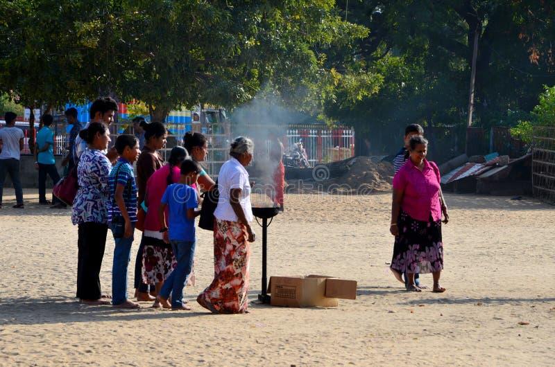 Sri Lankan Hindu Tamil worshippers make offerings at compound of Nallur Kandaswamy temple Jaffna Sri Lanka stock photography