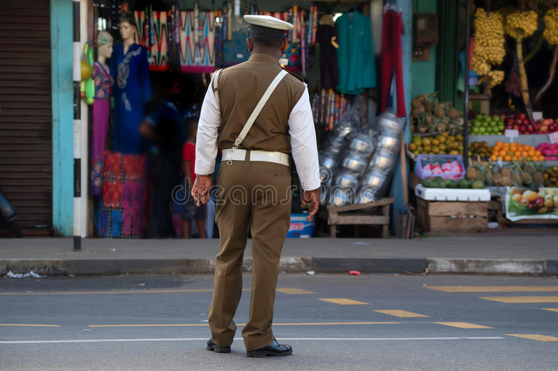 Sri Lankan policeman standing on street. Policeman standing on street in Sri Lanka. The Sri Lankan police force has a manpower of approximately 85,000 stock image