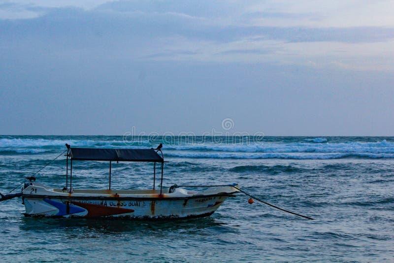 Sri Lankan traditional fishing boat docked in the sea. Image of Sri Lankan traditional fishing Colorful fishing boats docked in the port of Beruwala, Sri Lanka stock photography