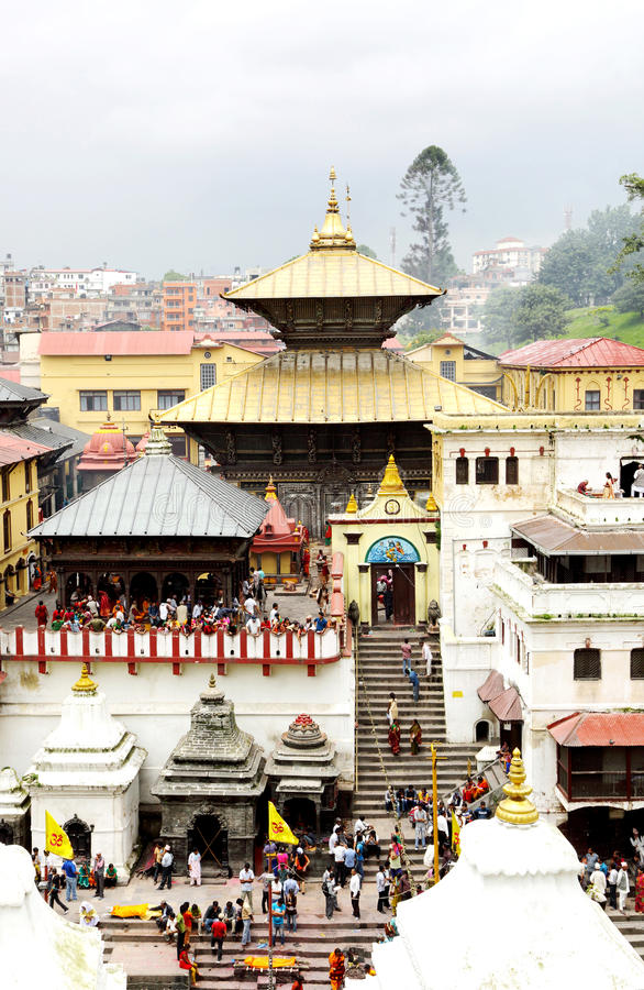 Sri Pashupatinath Temple located on banks of the Bagmati River. KATHMANDU, NEPAL-AUGUST 21: Devotees from various country visiting the Pashupatinath temple on stock photo