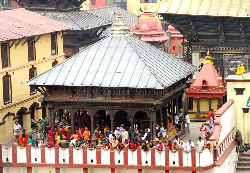 Sri Pashupatinath Temple located on the banks of Bagmati River. KATHMANDU, NEPAL-AUGUST 21: Devotees from various country visiting the Pashupatinath temple on royalty free stock images