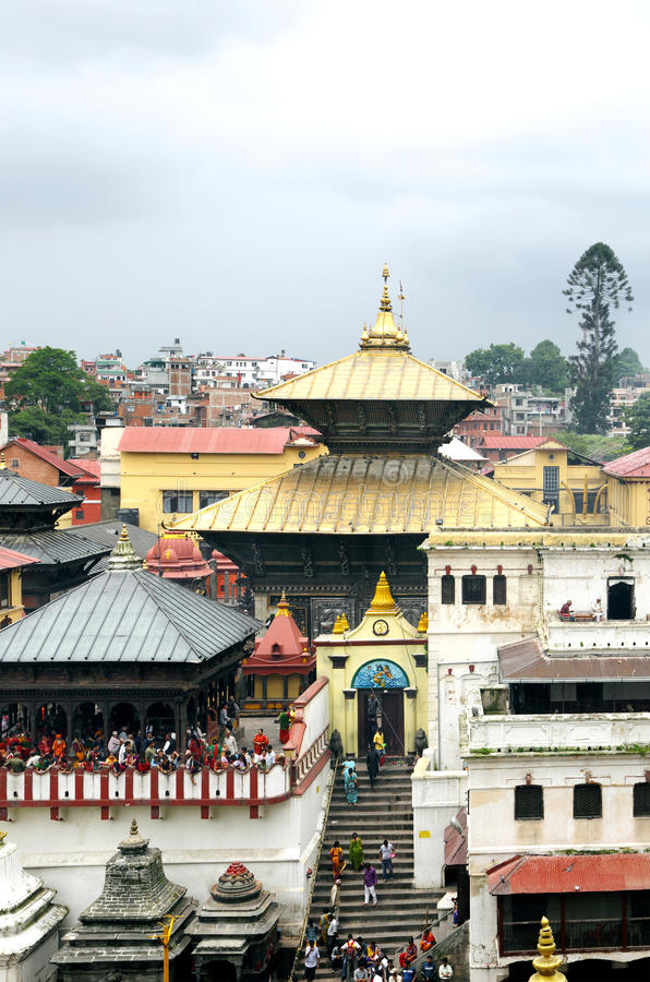 Sri Pashupatinath Temple located on the banks of Bagmati River. KATHMANDU, NEPAL-AUGUST 21: Devotees from various country visiting the Pashupatinath temple on stock image