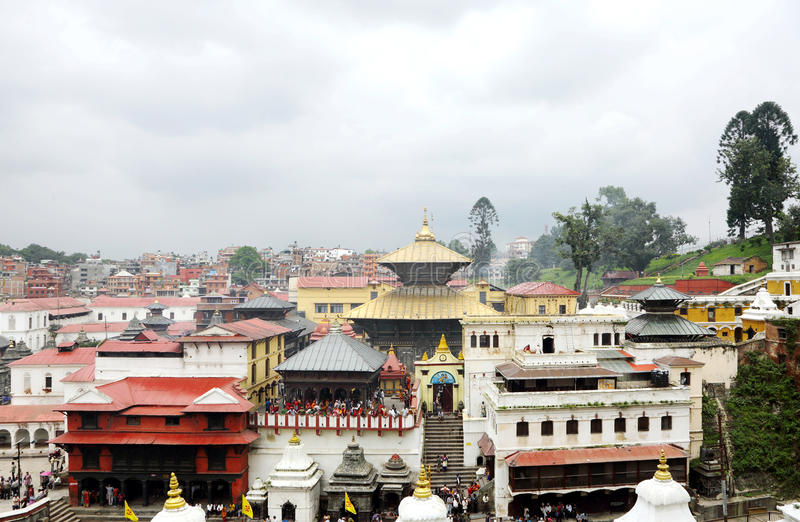 Sri Pashupatinath Temple located on the banks of Bagmati River. KATHMANDU, NEPAL-AUGUST 21: Devotees from various country visiting the Pashupatinath temple on stock images
