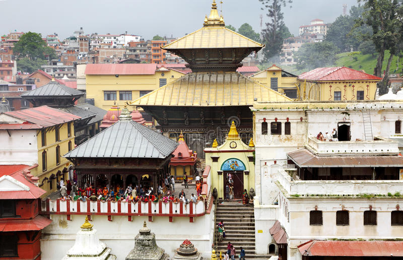 Sri Pashupatinath Temple located on the banks of Bagmati River. KATHMANDU, NEPAL-AUGUST 21: Devotees from various country visiting the Pashupatinath temple on stock photography