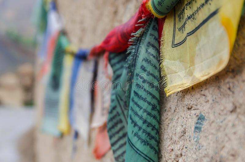 Multicolored flags with Tibetan prayer signs stock photo