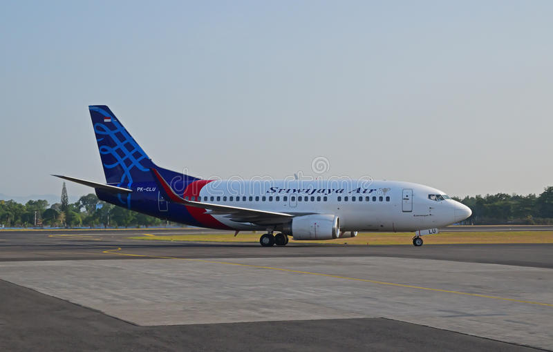 Sriwijaya Air plane is seen moving on airport runway in Indonesia stock photography