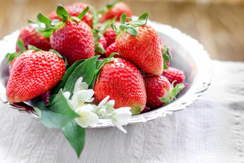 Srtawberry, fresh organic strawberies nd flower jasmine stock photo
