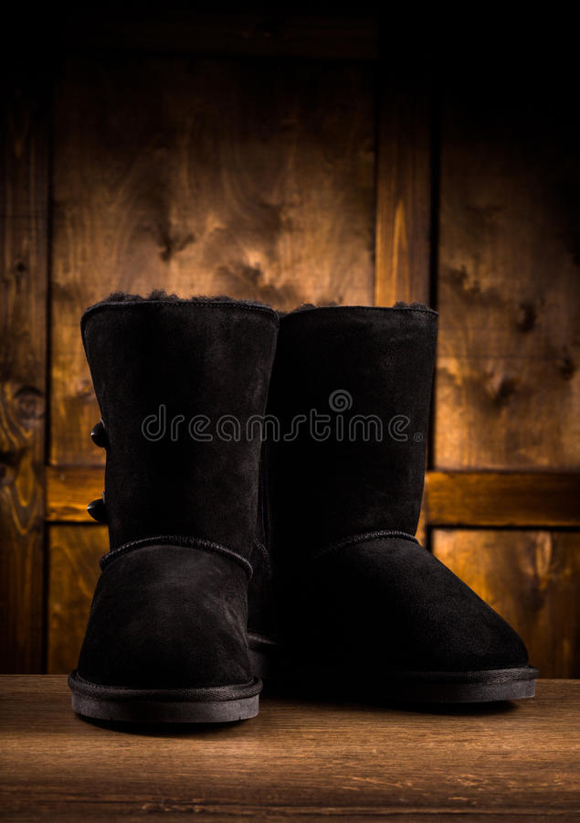 Srudio shot of pair of suede winter boots. stock photography