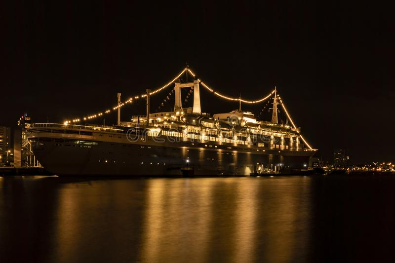 SS Rotterdam by night at Katendrecht quay stock photos