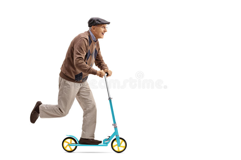 Ssenior riding a scooter royalty free stock image