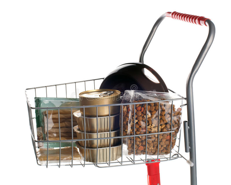 Sshopping cart full of dog food. On white background stock images